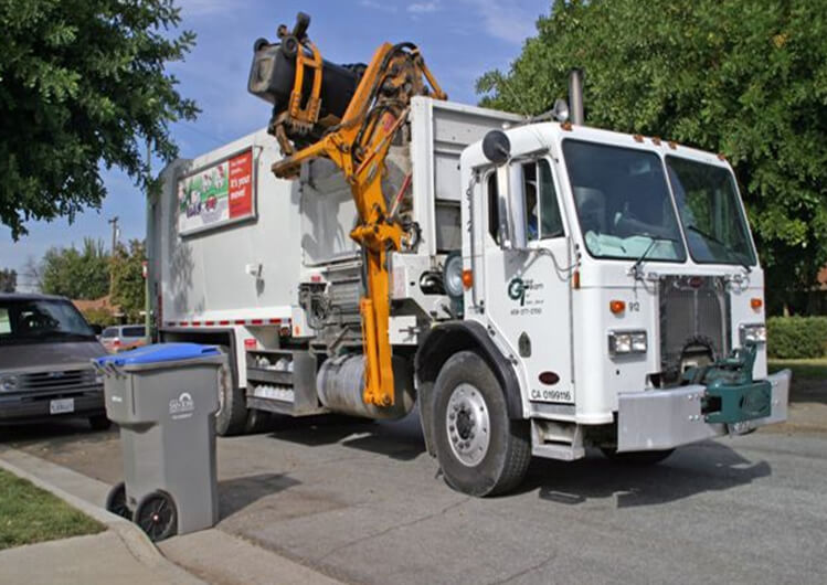 Green Team of San Jose side load garbage truck collecting waste.